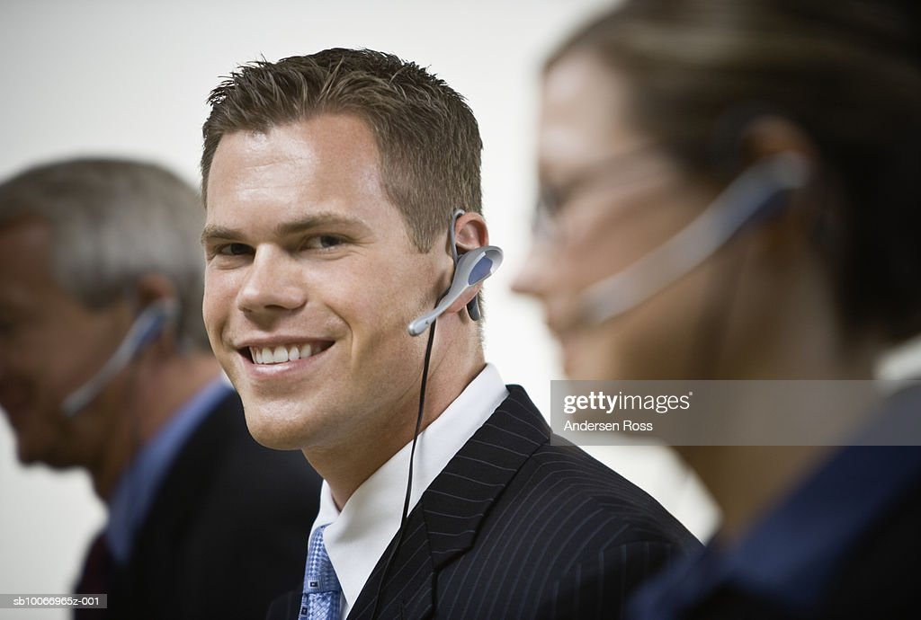 Customer service representatives at work, differential focus : Stock Photo