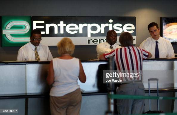 Customer service representatives Oneal West Marmontel Michel and Benjamin Meyer wait on customers at Enterprise rentacar at the Fort...