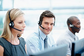 Customer service team wearing headsets in a call center