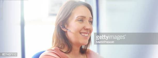 Customer services representitive happily solving customer problems
