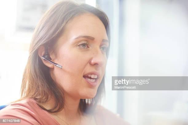 Customer services representitive talking to customer