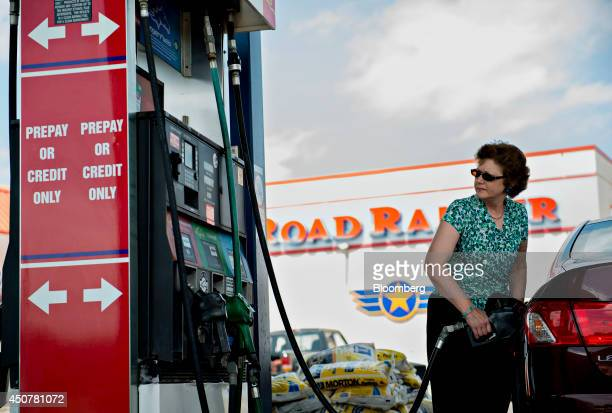 Customer Shelly Grabill fuels her vehicle at a Road Ranger gas station in Princeton Illinois US on Tuesday June 17 2014 Gasoline in the US climbed...