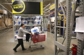 A customer shops at a Lowe's home improvement store on January 24 2013 in Chicago Illinois Lowe's said they plan to hire 45000 parttime workers this...