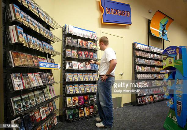A customer shops at Blockbuster Video on November 11 2004 in Wilsonville Oregon Blockbuster Inc offered to buy Hollywood Video today at a price of...