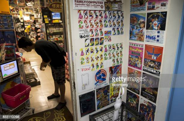 A customer shops at the Super Potato video game store in the Akihabara district of Tokyo Japan on Tuesday Aug 8 2017 Renewed interest in vintage...