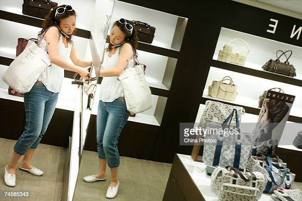 A customer shops for a Celine handbag in a dutyfree DFS Galleria on June 13 2007 in Hong Kong China The Consumer Council pledged to work with...