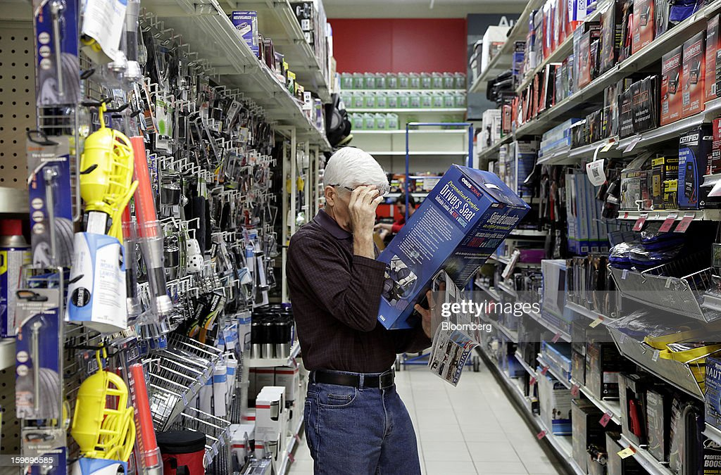 A customer shops for a driver's seat cushion at a Canadian Tire Corp. store in Toronto, Ontario, Canada, on Friday, Jan. 18, 2013. STCA - Statistics Canada is scheduled to release retail sales data on Jan. 21. Photographer: Reynard Li/Bloomberg via Getty Images