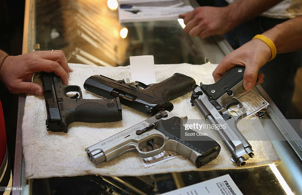 A customer shops for a gun at Freddie Bear Sports sporting goods store on January 19 2012 in Tinley Park Illinois Gun rights supporters have...
