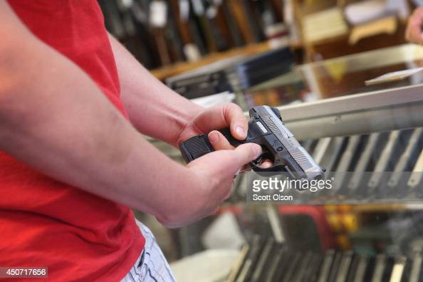 A customer shops for a handgun at Freddie Bear Sports on June 16 2014 in Tinley Park Illinois In a 54 decision the Supreme Court ruled that it is a...