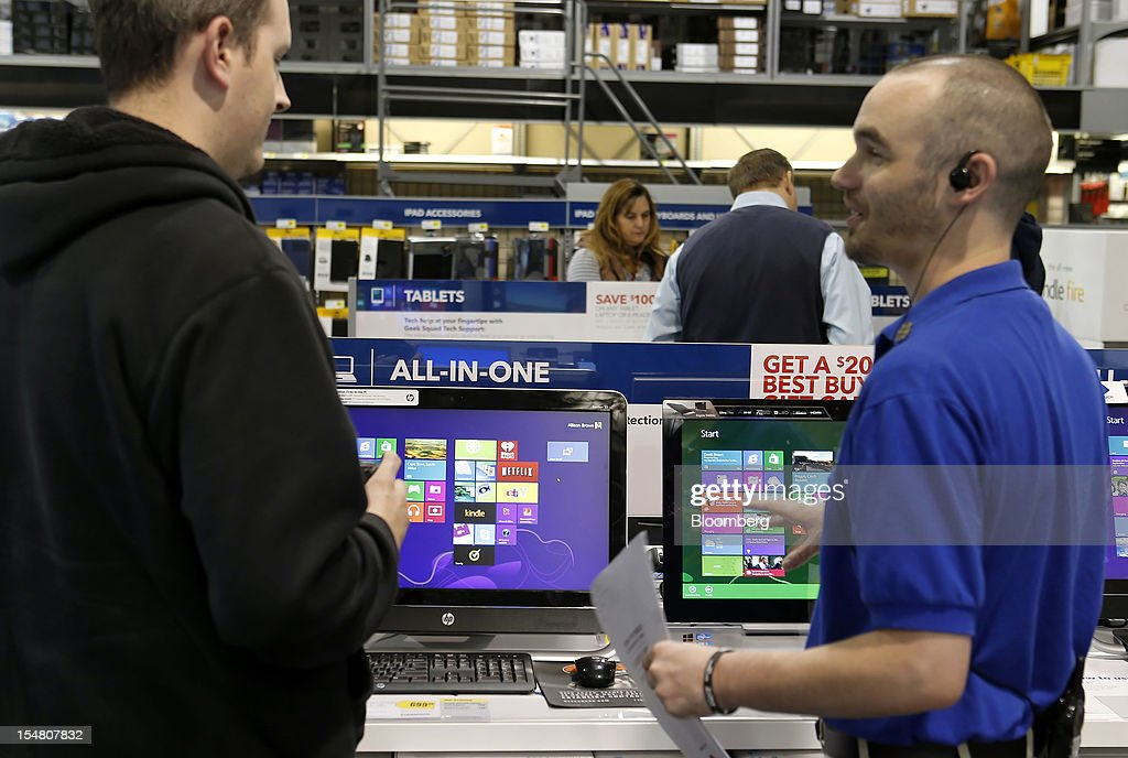 A customer shops for a laptop running the Microsoft Corp. Windows 8 operating system at a Best Buy Co. store in Orem, Utah, U.S., on Friday, Oct. 26, 2012. Microsoft Corp. introduced the biggest overhaul of its flagship Windows software in two decades, reflecting the rising stakes in its competition with Apple Inc. and Google Inc. for the loyalty of customers who are shunning personal computers and flocking to mobile devices. Photographer: George Frey/Bloomberg via Getty Images