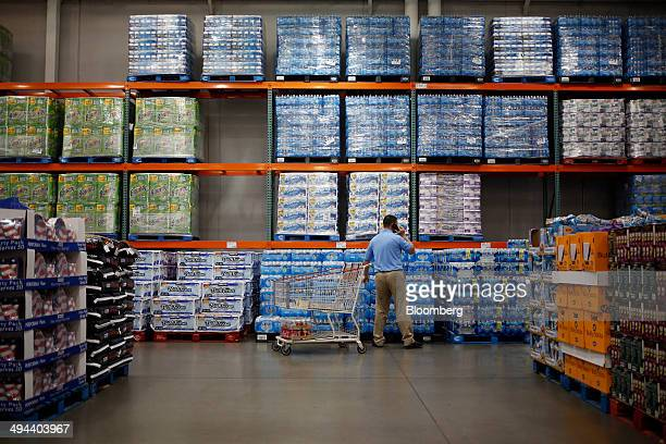 A customer shops for bottled water at a Costco Wholesale Corp store in Louisville Kentucky US on Thursday May 29 2014 Costco Wholesale Corp the...