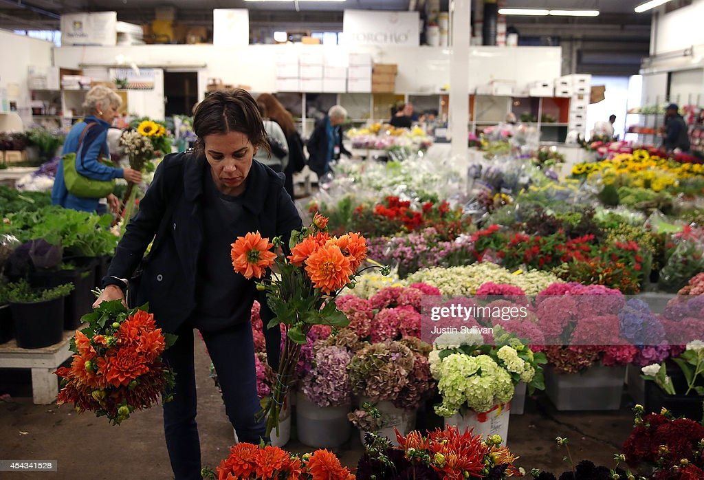 A customer shops for flowers at the San Francisco Flower Mart on August 29, 2014 in San Francisco, California. The future of more than 100 flower businesses at the historic San Francisco Flower Mart hangs in the balance as Los Angeles based realty group Kilroy Realty Corp. is planning on purchasing the Flower Mart property. Kilroy has proposed a plan to build a tech campus on the site.