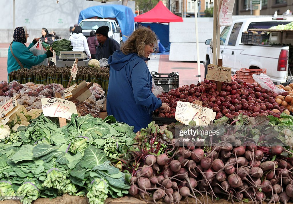 A customer shops for fresh vegetables at a farmers market on March 16, 2011 in San Francisco, California. Wholesale prices in the United States spiked last month with a 3.3% rise in energy prices and a 3.9% jump in food prices.