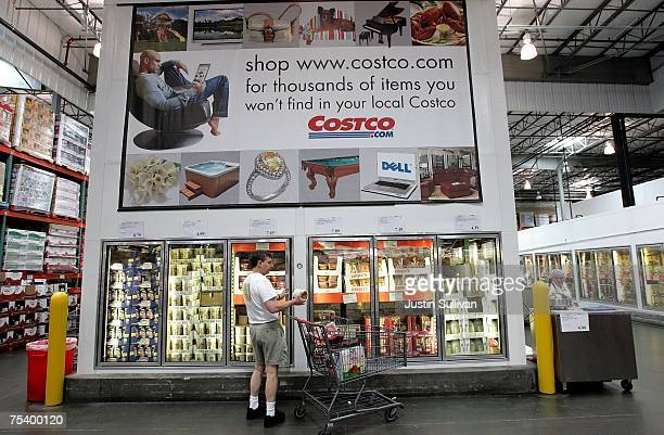 A customer shops for groceries at a Costco warehouse store July 13 2007 in Richmond California Costco Wholesale Corporation reported a six percent...