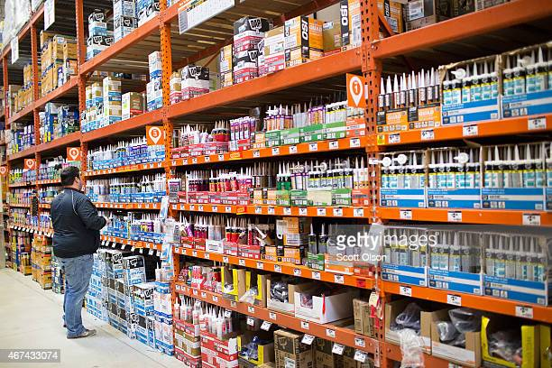 A customer shops for home improvement products at a Home Depot store on March 24 2015 in Chicago Illinois The Labor Department reported the...