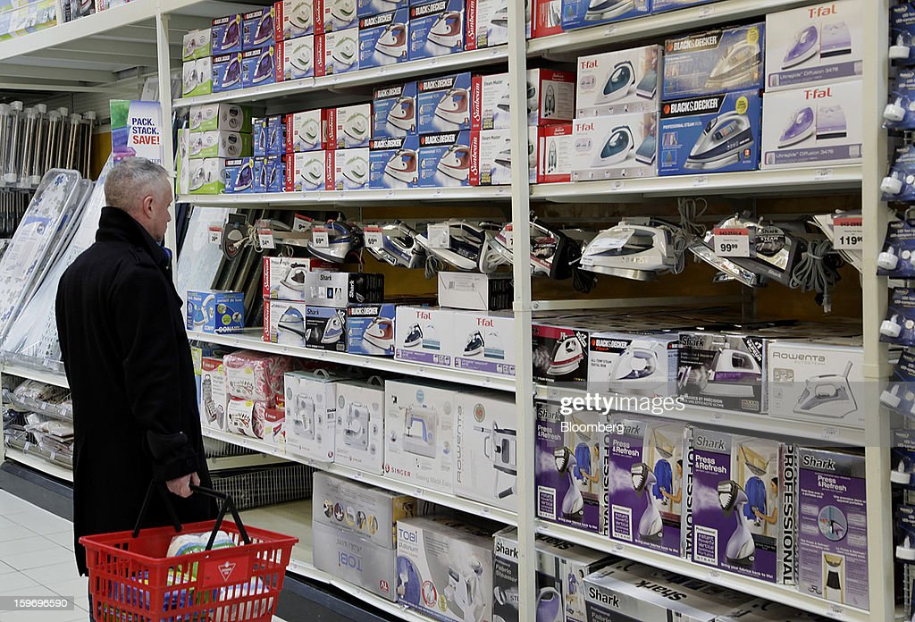 A customer shops for irons at a Canadian Tire Corp. store in Toronto, Ontario, Canada, on Friday, Jan. 18, 2013. STCA - Statistics Canada is scheduled to release retail sales data on Jan. 21. Photographer: Reynard Li/Bloomberg via Getty Images