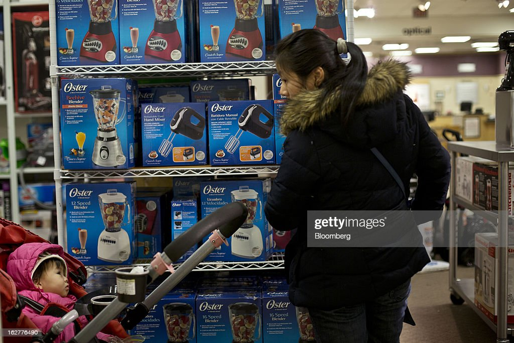 A customer shops for kitchen appliances at a J.C. Penney Co. store in the Queens borough of New York, U.S., on Tuesday, Feb. 26, 2013. Confidence among U.S. consumers jumped more than forecast in February as Americans adjusted to a higher payroll tax and signs of a recovering housing market spurred faith in the future. J.C. Penney Co. is scheduled to release earnings data on Feb. 27. Photographer: Victor J. Blue/Bloomberg via Getty Images