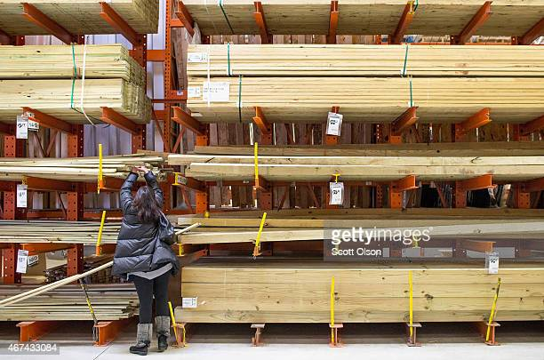 A customer shops for lumber at a Home Depot store on March 24 2015 in Chicago Illinois The Labor Department reported the consumerprice index rose a...