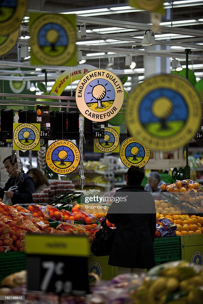 A customer shops for oranges in the fruit and vegetable department inside a Carrefour SA supermarket in Portet sur Garonne, near Toulouse, France, on Tuesday, March 5, 2013. Carrefour's stock has risen 47 percent since Georges Plassat's arrival as chief executive officer, partially offsetting a 71 percent decline in the preceding five years. Photographer: Balint Porneczi/Bloomberg via Getty Images