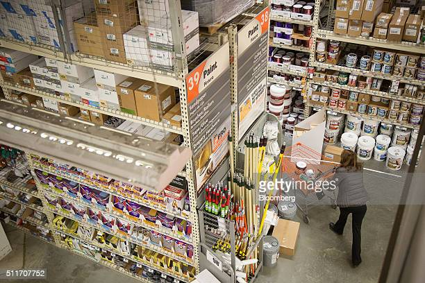 A customer shops for paint at a Home Depot Inc store in Jersey City New Jersey US on Saturday Feb 20 2016 Home Depot may exceed its 2015 forecast of...