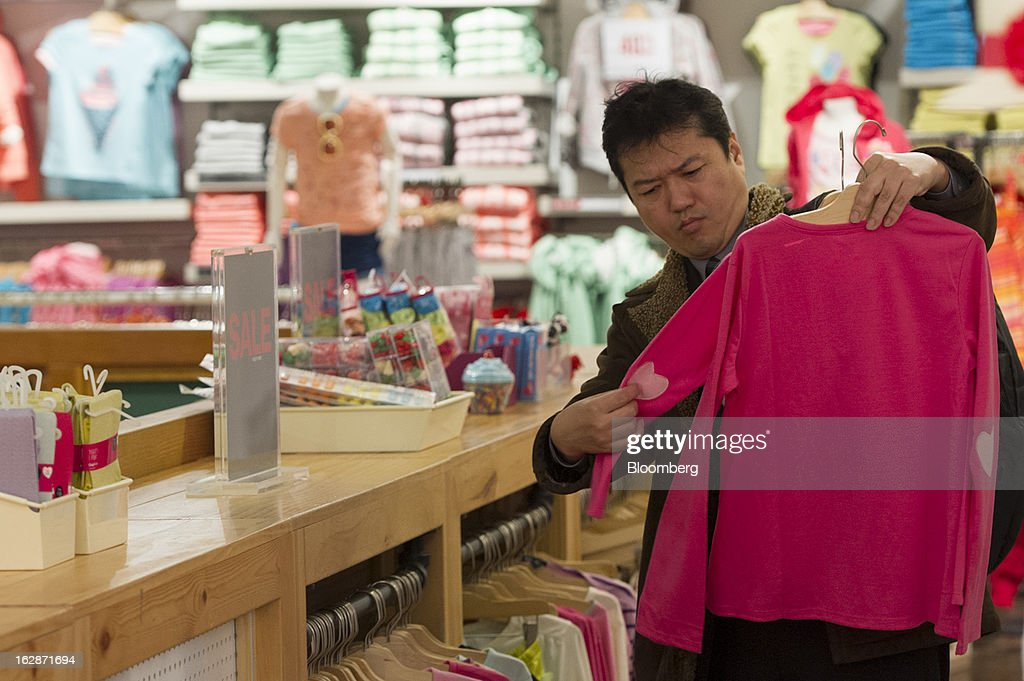 A customer shops for pink shirts at a Gap Inc. store in San Francisco, California, U.S., on Thursday, Feb. 28, 2013. Gap Inc., the biggest U.S. specialty-apparel retailer, rose after posting fourth-quarter profit that topped analysts' estimates, fueled by its best holiday shopping season in six years. Photographer: David Paul Morris/Bloomberg via Getty Images
