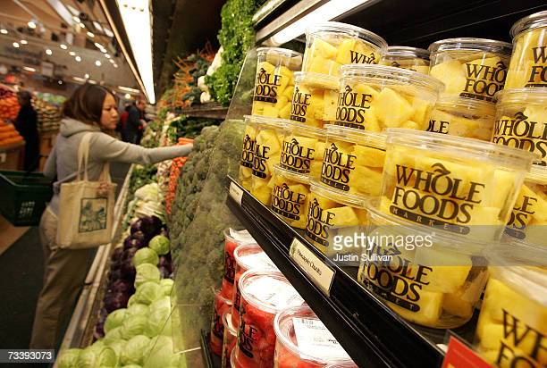 A customer shops for produce at a Whole Foods Market February 22 2007 in San Francisco California Whole Foods Market Inc announced that it plans to...