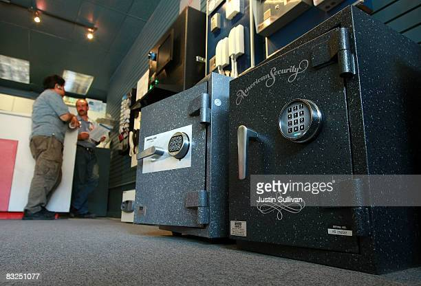 A customer shops for safes at Warman Security October 13 2008 in San Francisco California As banks across the US fail and the economy falters sales...