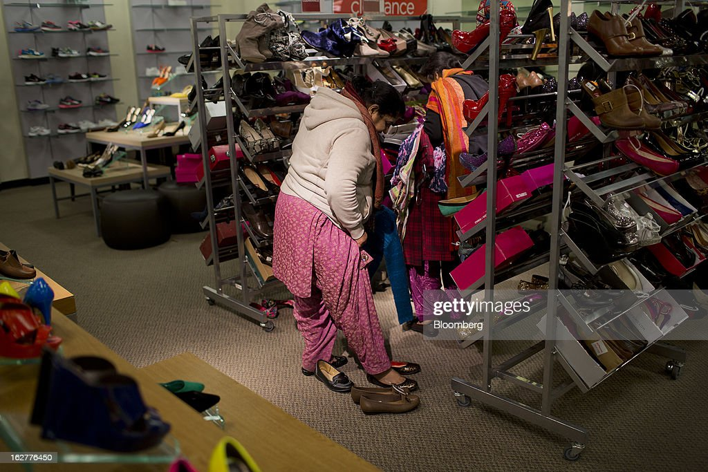 A customer shops for shoes at a J.C. Penney Co. store in the Queens borough of New York, U.S., on Tuesday, Feb. 26, 2013. Confidence among U.S. consumers jumped more than forecast in February as Americans adjusted to a higher payroll tax and signs of a recovering housing market spurred faith in the future. J.C. Penney Co. is scheduled to release earnings data on Feb. 27. Photographer: Victor J. Blue/Bloomberg via Getty Images
