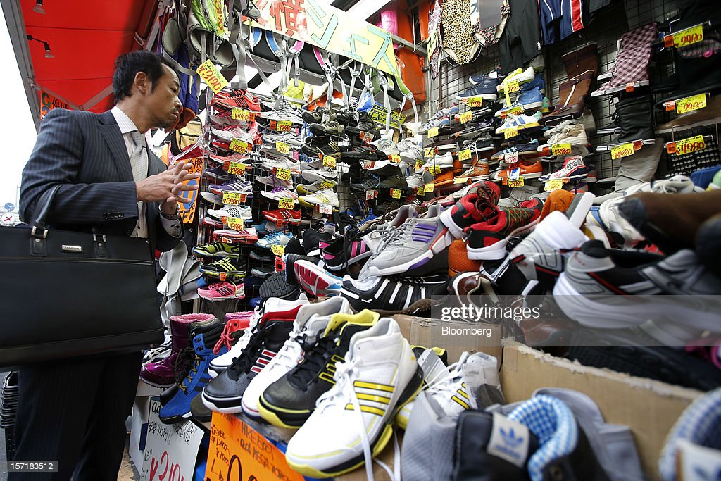 A customer shops for shoes in the Ueno district of Tokyo, Japan, on Thursday, Nov. 29, 2012. Japan's cabinet approved a second round of fiscal stimulus worth 880 billion yen ($10.7 billion) using budget reserves as Prime Minister Yoshihiko Noda attempts to boost the economy before elections on Dec. 16. Photographer: Kiyoshi Ota/Bloomberg via Getty Images