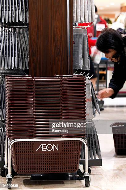 A customer shops for underwear during a discount sale at Aeon Co's Jusco store in the Aeon Lake Town shopping mall in Koshigaya City Saitama...