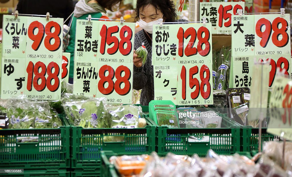 A customer shops for vegetables at a supermarket in Tokyo, Japan, on Tuesday, April 9, 2013. After Bank of Japan Governor Haruhiko Kuroda's first policy meeting as governor on April 4, the central bank set a two-year horizon for the 2 percent annual price-increase target that it adopted in January at the urging of Prime Minister Shinzo Abe. Photographer: Tomohiro Ohsumi/Bloomberg via Getty Images