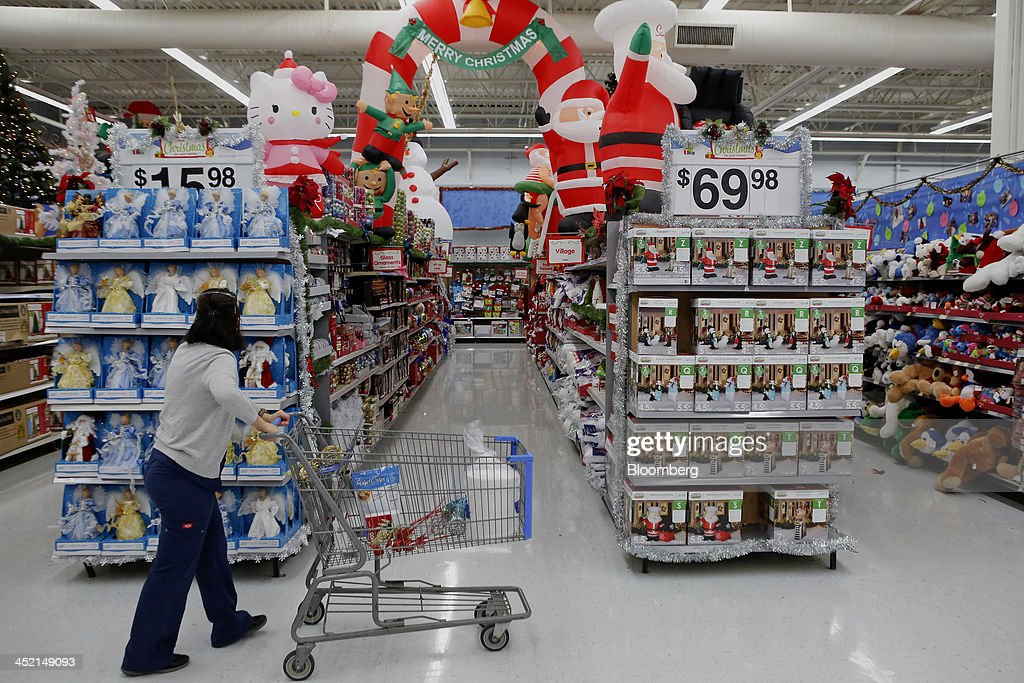 A customer shops holiday decorations for sale at a Wal-Mart Stores Inc. location ahead of Black Friday in Los Angeles, California, U.S., on Tuesday, Nov. 26, 2013. Wal-Mart Stores Inc. said Doug McMillon, head of its international business, will replace Mike Duke as chief executive officer when he retires as the world's largest retailer struggles to ignite growth at home and abroad. Photographer: Patrick T. Fallon/Bloomberg via Getty Images