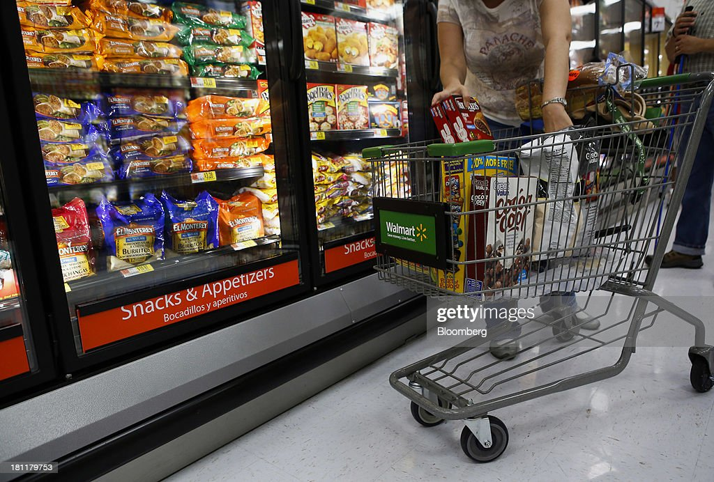 A customer shops in the frozen food section during the grand opening of a Wal-Mart Stores Inc. location in the Chinatown neighborhood of Los Angeles, California, U.S., on Thursday, Sept. 19, 2013. Wal-Mart Stores Inc. will phase out 10 chemicals it sells in favor of safer alternatives and disclose the chemicals contained in four product categories, the company announced Sept. 12. Photographer: Patrick T. Fallon/Bloomberg via Getty Images