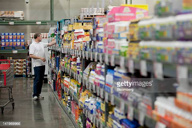 A customer shops inside a BJ's Wholesale Club Inc store in Falls Church Virginia US on Tuesday March 27 2012 The US Bureau of Economic Analysis is...