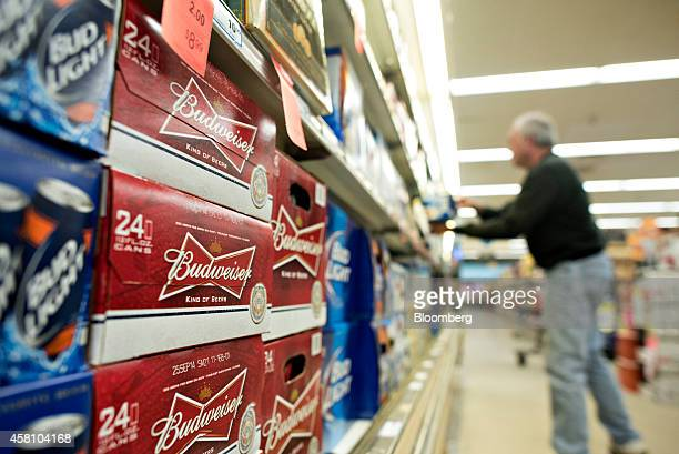 A customer shops near a display of AnheuserBusch Budweiser brand beer in a supermarket in Princeton Illinois US on Tuesday Oct 28 2014 AnheuserBusch...