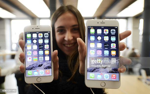 A customer shows the new products of Apple iPhone 6 and iPhone 6 Plus at an Apple Store in Madrid Spain on September 26 2014 The iPhone 6 and iPhone...