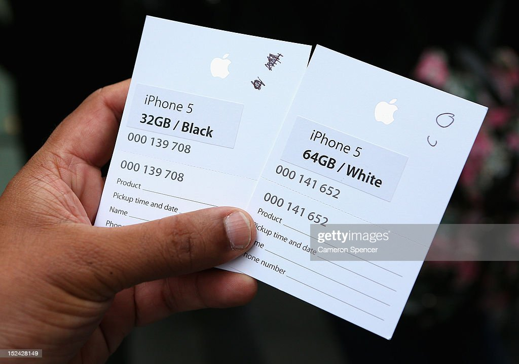 A customer shows tickets received in the queue for the iPhone 5 smartphone at the Apple flagship store on George street on September 21, 2012 in Sydney, Australia. Australian Apple stores are the first in the world to receive and sell the new iPhone 5 handsets.