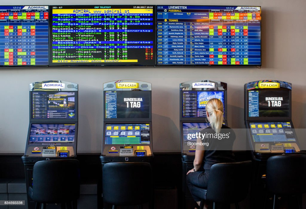 A customer sits at an electronic betting terminal inside an Admiral Casinos & Entertainment AG casino, operated by Novomatic AG, in Wiener Neudorf, Austria, on Thursday, Aug. 17, 2017. Novomatic is preparing for an initial public offering that could value the Austrian casino and gaming business at about 6 billion euros ($6.3 billion), according to people familiar with the matter. Photographer: Lisi Niesner/Bloomberg via Getty Images