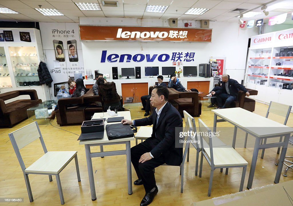 A customer sits in a Lenovo Group Ltd. store inside a shopping mall in Beijing, China, on Wednesday, March 6, 2013. China maintained its economic-growth target at 7.5 percent for 2013 while setting a lower inflation goal of 3.5 percent, setting up a challenge for new leaders to keep prices in check without harming expansion. Photographer: Tomohiro Ohsumi/Bloomberg via Getty Images