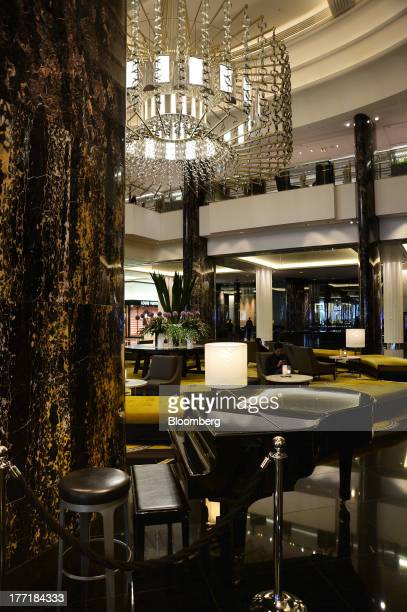 A customer sits in the lobby area of the Crown Towers hotel part of the Crown Melbourne casino and entertainment complex operated by Crown Ltd in...