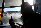 A customer smokes an ECigarette at Digita Ciggz on January 28 2015 in San Rafael California The California Department of Public Health released a...