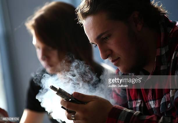 A customer smokes an ECigarette at Digital Ciggz on January 28 2015 in San Rafael California The California Department of Public Health released a...