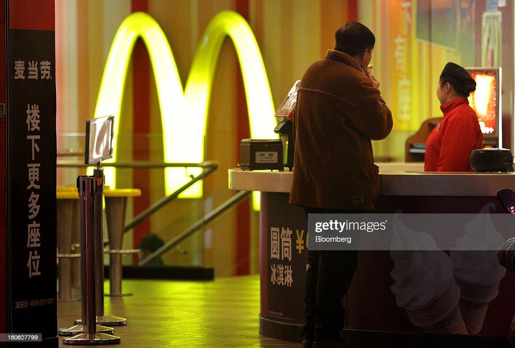 A customer stands at the counter at a McDonald's Corp. restaurant in Shanghai, China, on Friday, Feb. 1, 2013. China's services industries grew at the fastest pace since August as gains in retailing and construction aid government efforts to drive a recovery in the world's second-biggest economy. Photographer: Tomohiro Ohsumi/Bloomberg via Getty Images