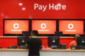 A customer stands at the service desk inside a Vodacom store at Vodaworld the headquarters of Vodacom Group Ltd Vodafone's biggest African business...