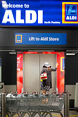 A customer stands at waits for a lift inside an Aldi supermarket store in London UK on Monday June 29 2015 The growth of Aldi and fellow Germanowned...