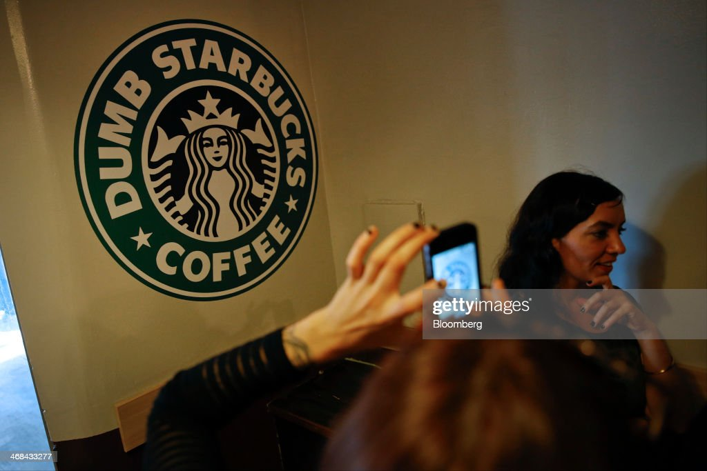 A customer take a photograph at the Dumb Starbucks Coffee store, a parody of the Starbucks Corp. coffee chain, in Los Angeles, California, U.S., on Monday, Feb. 10, 2014. Dumb Starbucks, which opened this past weekend, offered Dumb Vanilla Blonde Roast, Dumb Chai Tea Latte, and Dumb Caramel Macchiato, all available in sizes Dumb Venti, Dumb Grande, and Dumb Tall. Photographer: Patrick T. Fallon/Bloomberg via Getty Images
