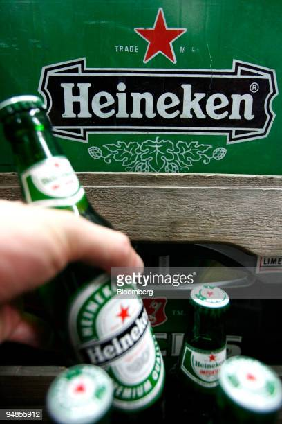 A customer takes a bottle of Heineken beer for sale at a shop in Berlin Germany on Tuesday Aug 26 2008 Heineken NV the world's thirdlargest brewer...