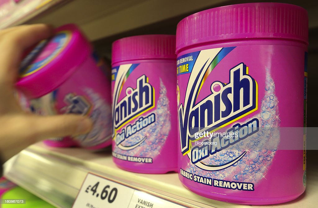 A customer takes a tub of Vanish stain remover, produced by Reckitt Benckiser Group Plc, from the shelf inside a supermarket in London, U.K., on Friday, Feb. 8, 2013. Britain's economy will grow more slowly this year than previously forecast and stagnation may persist, according to the National Institute of Economic and Social Research. Photographer: Chris Ratcliffe/Bloomberg via Getty Images