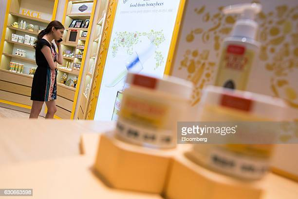 A customer talks on a smartphone while browsing inside a Burt's Bees Inc store a subsidiary of Clorax Co in Seoul South Korea on Thursday July 2 2015...