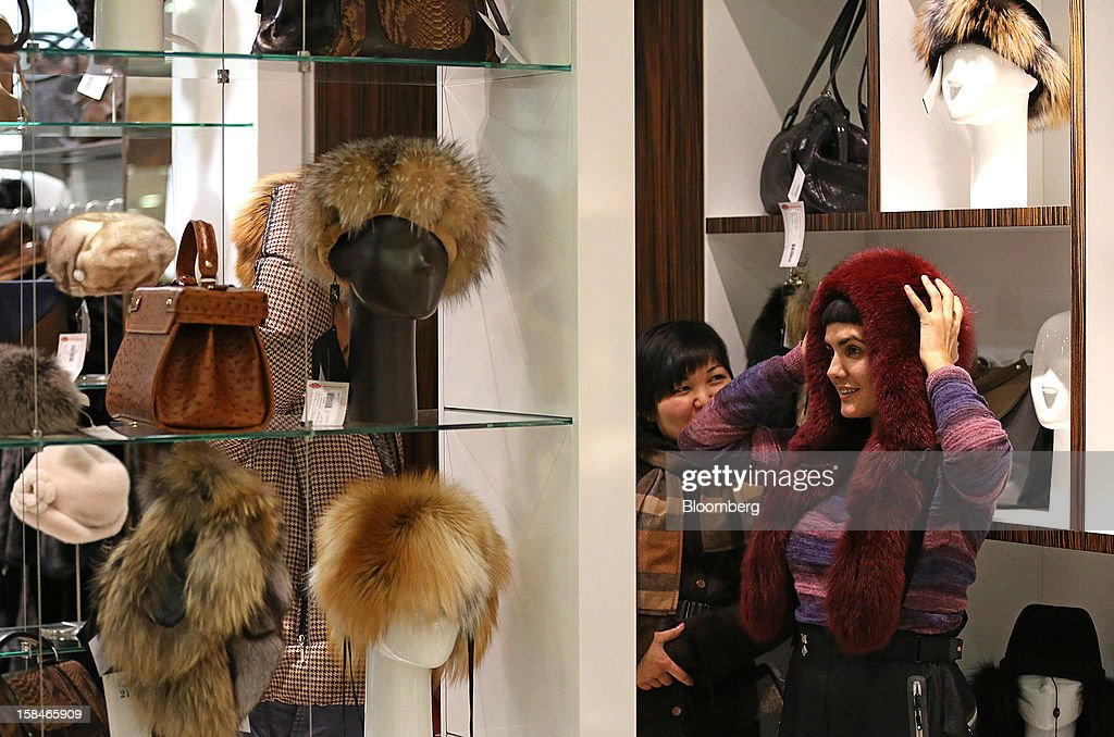 A customer tries on a fur hat at the World of Fur and Leather store in Moscow, Russia, on Sunday, Dec. 16, 2012. Russia's government should introduce a tax on luxury consumption in first half of 2013, President Vladimir Putin said in state-of-the-nation address in Moscow. Photographer: Andrey Rudakov/Bloomberg via Getty Images